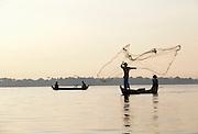 Fishermen cast nets on the Irrawaddy River, near Mandalay, Myanmar