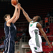 Anadolu Efes's Stanko BARAC (L) and Panathinaikos's Romain Lebel GUESSAGBA (R) during their Two Nations Cup basketball match Anadolu Efes between Panathinaikos at Abdi Ipekci Arena in Istanbul Turkey on Saturday 01 October 2011. Photo by TURKPIX