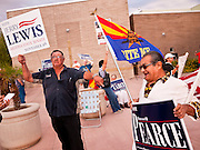 06 OCTOBER 2011 - MESA, AZ: Lewis supporter Al Moncayo (CQ) and Pearce supporter Arthur Olivas rally at the debate between Jerry Lewis and Russell Pearce in Mesa Thursday. Lewis is challenging Pearce in Pearce's recall election after residents of Pearce's district signed petitions calling for the recall the President of the Arizona State Senate.  PHOTO BY JACK KURTZ