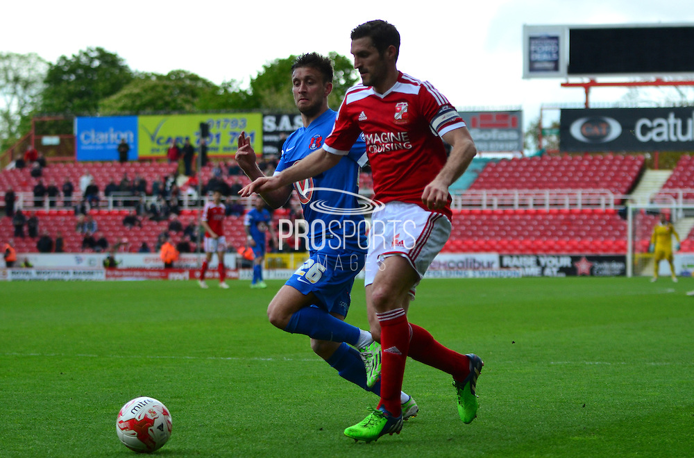 Samuel Ricketts about to be fouled for the penalty by Luke O'Neill during the Sky Bet League 1 match between Swindon Town and Leyton Orient at the County Ground, Swindon, England on 3 May 2015. Photo by Alan Franklin.