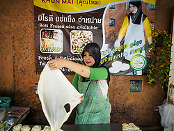 September 1, 2017 - Bangkok, Bangkok, Thailand - A woman makes roti at the celebration of Eid al-Adha at Haroon Mosque in Bangkok. Eid al-Adha is also called the Feast of Sacrifice, the Greater Eid or Baqar-Eid. It honours the willingness of Abraham to sacrifice his son. Goats, sheep and cows are sacrificed in a ritualistic manner after services in the mosque. The meat from the sacrificed animal is supposed to be divided into three parts. The family retains one third of the share; another third is given to relatives, friends and neighbors; and the remaining third is given to the poor and needy. (Credit Image: © Sean Edison via ZUMA Wire)