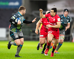 Scott Otten of Ospreys under pressure from Alex Lozowski of Saracens<br /> <br /> Photographer Simon King/Replay Images<br /> <br /> European Rugby Champions Cup Round 5 - Ospreys v Saracens - Saturday 11th January 2020 - Liberty Stadium - Swansea<br /> <br /> World Copyright © Replay Images . All rights reserved. info@replayimages.co.uk - http://replayimages.co.uk