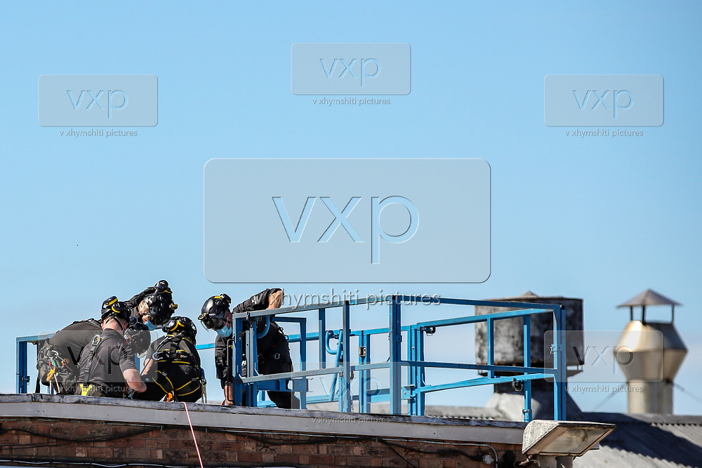 Birmingham, United Kingdom, June 15, 2021: Protestor Removal Unit of the British police are seen carrying one of Palestine Action activists who occupied Arconic factory site building in Birmingham on Tuesday, June 15, 2021. (VX Photo/ Vudi Xhymshiti)
