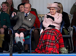File photo dated 07/09/13 of Queen Elizabeth II accompanied by the Duke of Edinburgh attending the Braemar Gathering in Braemar. The couple had a strong bond but were different in character and the Duke of Edinburgh never shied away from telling his wife exactly what was what. Issue date: Friday April 9, 2021.