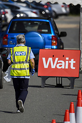 © Licensed to London News Pictures. 17/09/2020. WATFORD, UK.  An NHS worker at the Covid-19 testing centre outside Watford General Hospital in Hertfordshire.  It is reported that the increased demand for Covid-19 tests has led to local shortages of testing slots and access to community testing has had to be rationed because labs are struggling to keep up with demand.  Photo credit: Stephen Chung/LNP