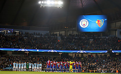 Players stand for a minute's silence in memory of the late Davide Astori before the UEFA Champions League round of 16, second leg match at the Etihad Stadium, Manchester.