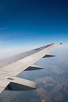 Wing of a plane as it flies into Krakow Poland