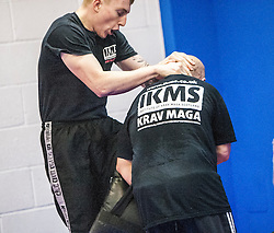 Students using their knees on the pads. Stef Noij, KMG Instructor from the Institute Krav Maga Netherlands, takes the IKMS G Level Programme seminar today at the Scottish Martial Arts Centre, Alloa.