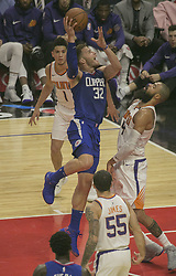 October 21, 2017 - Los Angeles, California, U.S - Blake Griffin #32 of the Los Angeles Clippers and Devin Booker #1 and Tyson Chandler #4 of the Phoenix Suns during their regular season game on Saturday October 21, 2017 at the Staples Center in Los Angeles, California. Clippers defeat Suns, 130-88. (Credit Image: © Prensa Internacional via ZUMA Wire)