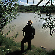 A US Border Patrol agent scans the Rio Grande River, a popular crossing point for undocumented immigrants entering Eagle Pass, Texas. Please contact Todd Bigelow directly with your licensing requests. PLEASE CONTACT TODD BIGELOW DIRECTLY WITH YOUR LICENSING REQUEST. THANK YOU!
