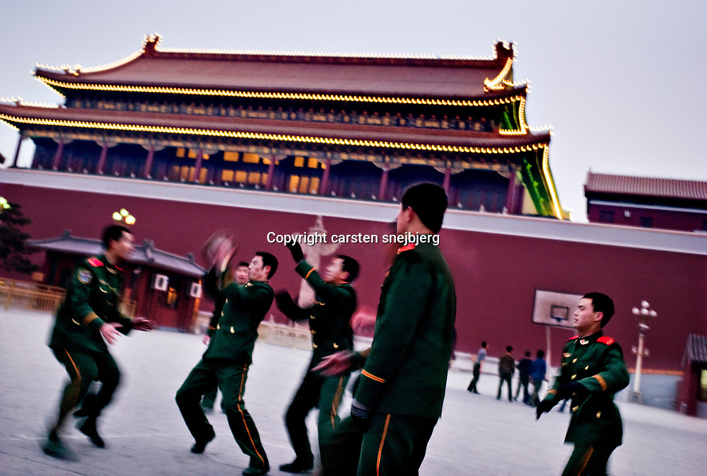 Guards playing basket ball in the forbidden city after duty in Beijing, China, on monday 14. jan, 2008