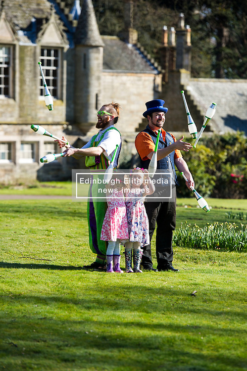 Pictured: Rob Thorburn (hat) and Will Borrell entertained Lily Donald (4 and floral hairband) and Isla Sutherland (4 bow headband) with their juggling skills.<br /> <br /> The Festival of Museums launch featured performers, Rob Thorburn (hat), Will Borrell, Alyssa Brough (blue jacket) and Kate McWilliam from Circus Alba showcasing their skills.<br /> <br /> Ger Harley   EEm 30 March 2016
