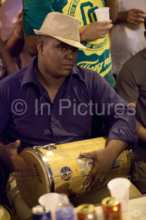 Drummer man playing a drum, Pedra do Sal, the birthplace of Samba, in Gamboa district which was the neighbourhood where the ex slaves lived after abolition, sometimes referred to as the first favela. Rio de Janeiro, Brazil