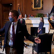 An aide ushers out media after President Donald Trump's Supreme Court nominee Judge Amy Coney Barrett participates in a photo op with Sen. John Thune (R-S.D.) in the Mansfield Room of the U.S. Capitol prior to their meeting on Tuesday, September 29, 2020.