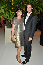 The HON.WILLIAM ASTOR and his wife LOHRALEE at a dinner hosted by Cartier in celebration of The Chelsea Flower Show held at The Hurlingham Club, London on 19th May 2014.