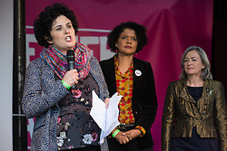 London, UK. 19 October, 2019. Claire Hanna, MLA for Belfast South, seen here with Chi Onwurah MP and Liz Saville Roberts MP, addresses hundreds of thousands of pro-EU citizens at the Together for the Final Say People's Vote rally in Parliament Square as MPs meet in a 'super Saturday' Commons session, the first such sitting since the Falklands conflict, to vote, subject to any amendments, on the Brexit deal negotiated by Prime Minister Boris Johnson with the European Union.