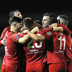 19/10/2018 - GOAL. Neil Mitchell of Newtown celebrates with team mates  after scoring to make it 3-0 during the JD Welsh Premier fixture between CPD Caernarfon Town and Newtown AFC at The Oval. <br /> <br /> Pic: Mike Sheridan/County Times<br /> MS231-2018