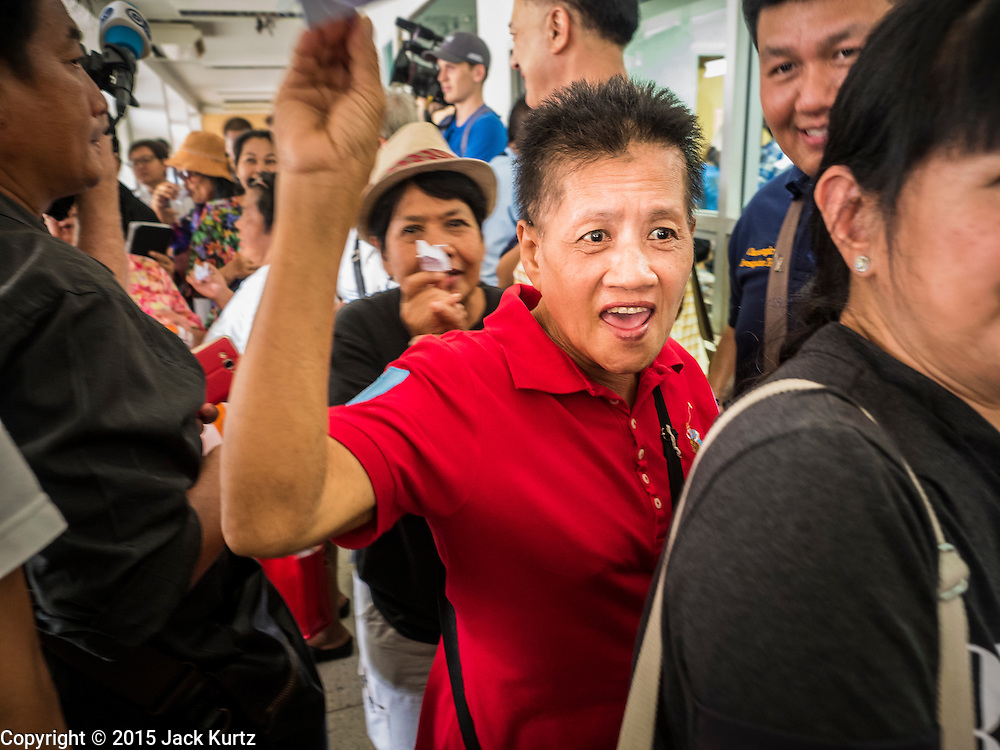 19 SEPTEMBER 2015 - BANGKOK, THAILAND:  Pro democracy protestors march through the halls of Thammasat University in Bangkok. Hundreds of people protested against Thailand's military dominated government Saturday. The protest started with seminar about the 2006 coup that deposed popularly elected former Prime Minister Thaksin Shinawatra. After the seminar activists marched from Thammasat University to Democracy Monument, about 1 mile. Political gatherings of more than 5 people are banned by Thailand's military government and police tried to dissuade the protestors from finishing their march. Protestors ignored the police, who then stood by and watched but made no effort to intervene. At Democracy Monument protestors laid flowers and made speeches against the military. It was the largest anti-coup protest in Bangkok in more than a year.    PHOTO BY JACK KURTZ