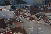 Aerial view of rooftops and TV antenna of the medieval district of Alfama in Lisbon, Portugal.
