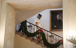 First Lady Melania Trump walks down the stairs to participate in arts and crafts projects with children and students from Joint Base Andrews in various rooms throughout the White House in Washington, DC, November 27, 2017.Photo by Olivier Douliery/Abaca Press