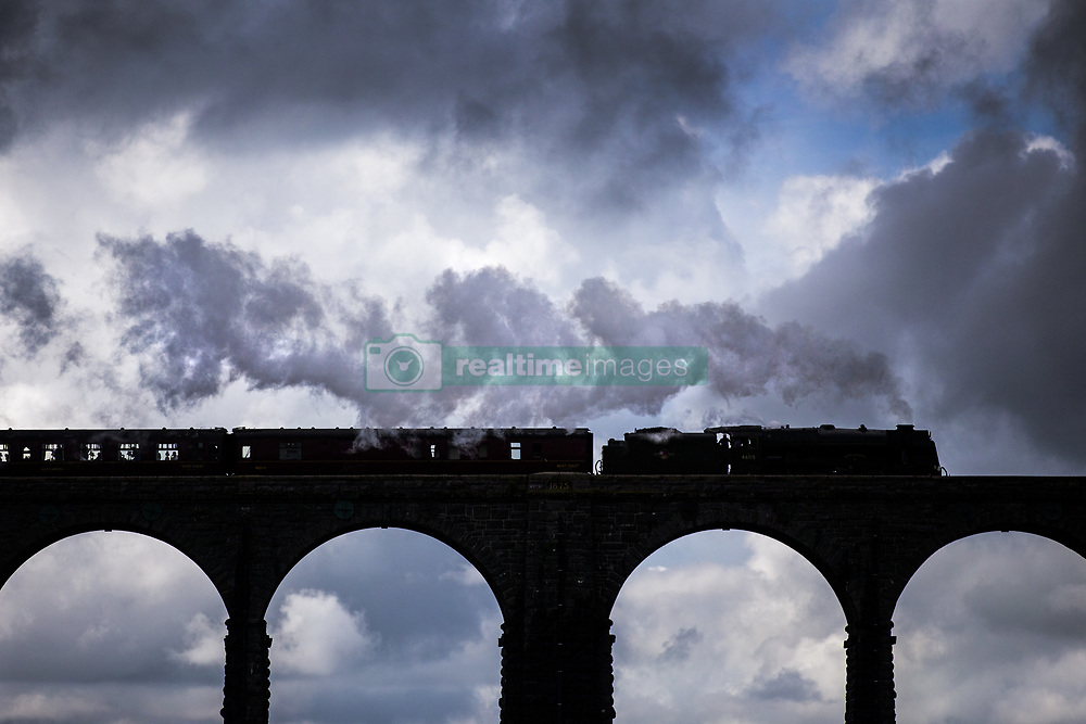 August 7, 2017 - Ribblehead, Yorkshire, UK - Ribblehead UK. The 46115 Scots Guardsman crosses the Ribblehead Viaduct in the Yorkshire Dales this afternoon on a mostly overcast day in Yorkshire. (Credit Image: © Andrew Mccaren/London News Pictures via ZUMA Wire)