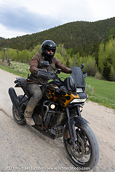 Danger Dan Hardick and his 2-week old Harley-Davidson Pan-America adventure bike on a gravel road just outside Red River, NM, USA. Saturday, May 29, 2021. Photography ©2021 Michael Lichter.