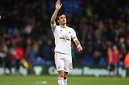 Jack Cork of Swansea City waves to his family after the final whistle. Barclays Premier League match, Crystal Palace v Swansea city at Selhurst Park in London on Monday 28th December 2015.<br /> pic by John Patrick Fletcher, Andrew Orchard sports photography.