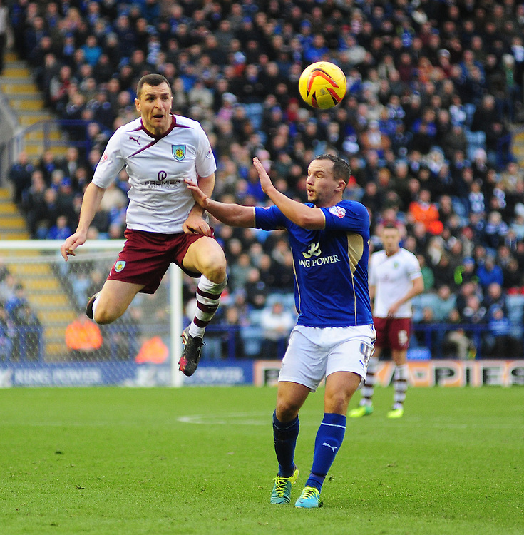Burnley's Dean Marney vies for possession with Leicester City's Daniel Drinkwater <br /> <br /> Photo by Chris Vaughan/CameraSport<br /> <br /> Football - The Football League Sky Bet Championship - Leicester City v Burnley - Saturday 14th December 2013 - King Power Stadium - Leicester<br /> <br /> © CameraSport - 43 Linden Ave. Countesthorpe. Leicester. England. LE8 5PG - Tel: +44 (0) 116 277 4147 - admin@camerasport.com - www.camerasport.com