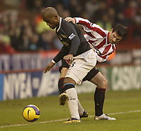 Photo: Aidan Ellis.<br /> Sheffield United v Manchester City. The Barclays Premiership. 26/12/2006.<br /> Sheffield's Keith Gillespie (R) trys to keep the ball in play from City's Sylvain Distin