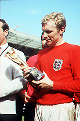 Library file 900/48/6 dated 30.7.66 Team captain Bobby Moore gazes down at the treasured trophy after England's victory over Germany in the 1966 World Cup. The 1996 England squad hope to recreate the famous victory when they meet Germany in Wednesday's Euro 96 semi-final clash at Wembley. See PA stories EURO 96.
