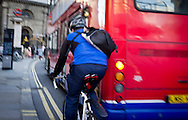 A Cyclist narrowly avoids being hit by a Bus in London, Britain - Nov 2011