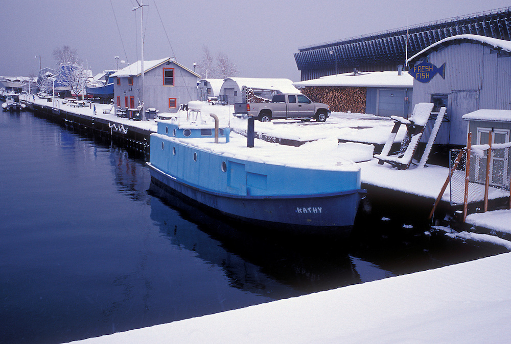 """The fishing boat """"Kathy"""" is covered with snow as she's docked at the Thill's Fish Dock in Marquette, Mich."""