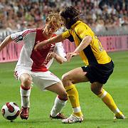 NLD/Amsterdam/20060928 - Voetbal, Uefa Cup voorronde 2006, Ajax - IK Start, Tom de Mul in duel met Todi Johnsson