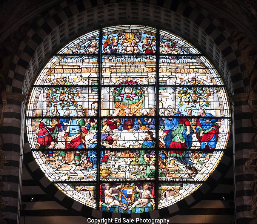 Stained glass window in the Siena Cathedral depicting the Last Supper of Christ. Created by Pastorino de Pastorini, and is considered to be an example of early Italian stained glass.