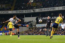 Tottenham's midfielder Nacer Chadli takes a shot at goal which is blocked by Sunderland's midfielder Lee Cattermole as Referee Lee Mason looks on  - Photo mandatory by-line: Mitchell Gunn/JMP - Tel: Mobile: 07966 386802 07/04/2014 - SPORT - FOOTBALL - White Hart Lane - London - Tottenham Hotspur v Sunderland - Premier League