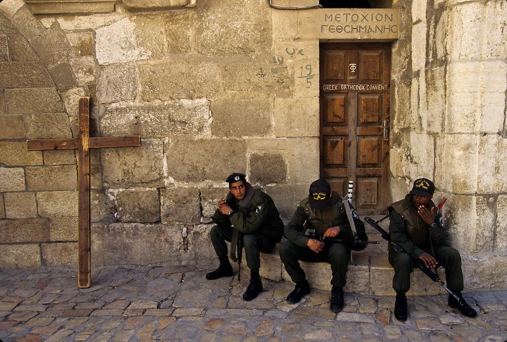 Soldiers outside of a Greek Orthodox Church in Jerusalem.