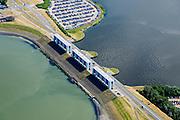 Nederland, Groningen, Gemeente de Marne, 05-08-2014; Lauwersoog met Lauwersmeer (voormalige Lauwerszee) en de Lauwerssluizen, de  R.J. Cleveringsluizen. Deze spuisluizen zijn uitwaterende sluizen tussen het meer en de Waddenzee.<br /> Lauwers Lake, former Lauwers Sea on the border between Groningen and Friesland (north Netherlands).<br /> luchtfoto (toeslag op standard tarieven);<br /> aerial photo (additional fee required);<br /> copyright foto/photo Siebe Swart