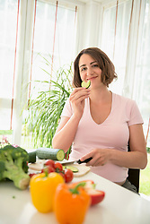Eating pregnant woman preparing healthy lunch