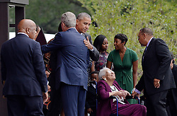U.S President Barack Obama hugs former President George W. Bush as Rep. John Lewis (L) looks on during the opening ceremony of the Smithsonian National Museum of African American History and Culture on September 24, 2016 in Washington, DC, USA. The museum is opening thirteen years after Congress and President George W. Bush authorized its construction. Photo by Olivier Douliery/Pool/ABACAPRESS.COM