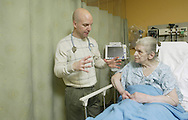 Physician's assistant Dave Williams listens to the heart of emergency department patient Emilie Abbruzzio at Ellenville Regional Hospital on Feb. 18, 2008.