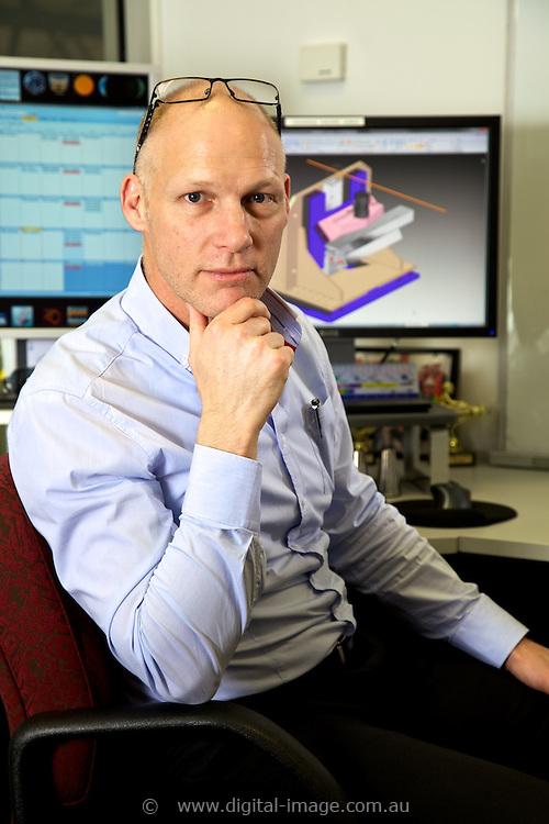 Mick Kusel, Principal Mechanical Engineer, Support Services, Australian Synchrotron, Engineering Deptartment, at desk