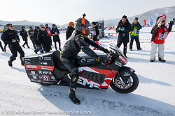 Mikhail Mikhin about to race on the mile track on the Moscow Polytechnic University electric motorcycle racer that was built for the Baikal Mile Ice Speed Festival. Maksimiha, Siberia, Russia. Saturday, February 29, 2020. Photography ©2020 Michael Lichter.