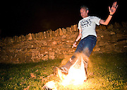 Fatboy Slim playing fire football at the lodge after the Rockness show .