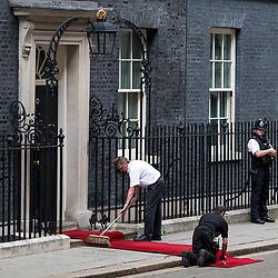 © Licensed to London News Pictures. 04/06/2019. London, UK. A red carpet is rolled out on the steps of 10 Downing Street ahead of the arrival of President of the United States of America, DONALD TRUMP and First Lady MELANIA TRUMP, on day two of a state visit to the UK. Photo credit: Ben Cawthra/LNP
