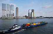 Freight transport in containers by ship on the river the Nieuwe Maas in Rotterdam, Netherlands.