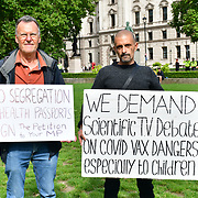 Parliament Square, London, UK. 2021-08-18. Piers Corbyn anti-vaxx attends the disgraceful war in Afghnistan. Piers strong voice the US/ UK government must accept the Afghan refugees. The two young  men are using BBC tactics to set up Piers Corbyn bribery has not stopped Piers continuing his anti-vaccine.