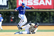 WINSTON-SALEM, NC - MARCH 04: Wake Forest's DJ Poteet (below) breaks up a double play attempt by UMass Lowell's Joey Castellanos (above). The Wake Forest University Demon Deacons hosted the UMass Lowell River Hawks on March 4, 2018, at David F. Couch Ballpark in Winston-Salem, NC in a Division I College Baseball game. Wake Forest won the game 14-7.