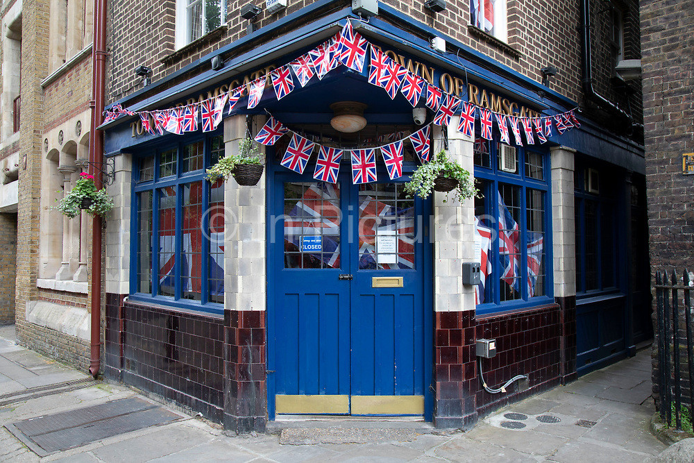 The Town of Ramsgate pub in Wapping, closed up due to Coronavirus and decked out in Union Jack flags, patriotic in support of VE Day as lockdown continues and people observe the stay at home message in the capital on 11th May 2020 in London, England, United Kingdom. Coronavirus or Covid-19 is a new respiratory illness that has not previously been seen in humans. While much or Europe has been placed into lockdown, the UK government has now announced a slight relaxation of the stringent rules as part of their long term strategy, and in particular social distancing.