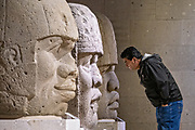 Tourist view colossal Olmec stone heads at the Museum of Anthropology in the historic center of Xalapa, Veracruz, Mexico. The Olmec civilization was the earliest known major Mesoamerican civilizations dating roughly from 1500 BCE to about 400 BCE.