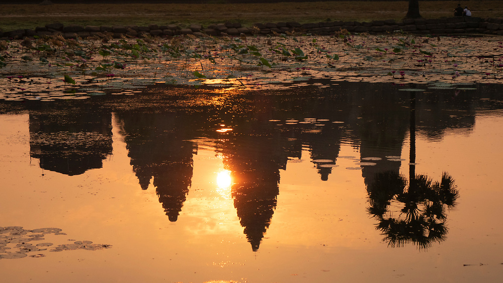 """Reflection of the sunrise at Angkor Wat Temple, Siem Reap, Cambodia<br /> The temple was originally dedicated to Lord Vishnu. The modern name, Angkor Wat, means """"City of Temples"""" in Khmer"""